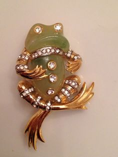 "This elegant frog was designed by Kenneth Jay Lane in 1969. He created this frogs brooch in a variety of colors and named them the ""Park Avenue Frog"" This mint condition frog is signed ""Kenneth Lane"" (not the later KJL). It measures 2"" by 1 1/4""."