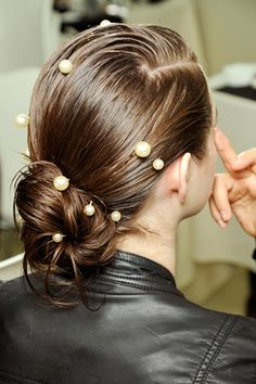 use a glue gun to attach pearl beads to bobby pins -decorate your hairstyles like  in Chanel's 2012 runway looks