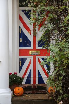 Notting Hill, London. I love the pumpkins in contrast to the Union Jack door!