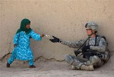 This little girl gave a flower for a solider