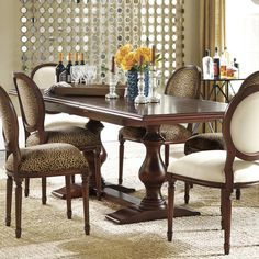 Vendome Double Pedestal Table. Love the upholstery on chairs!