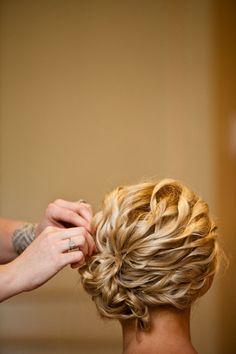 spiral curls gathered into a side bun |