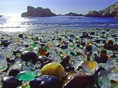Glass Beach, northern California - From 1950 to 1967, residents of Fort Bragg, California chose to dispose of their waste by hurling it off the cliffs above a beach. After cleanup programs, pounding waves turned the remaining glass into smooth stones.  It is now a state park.