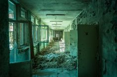 Abandoned corridor in a Pripyat school (City abandoned because of Chernobyl) I love the turquoise color and texture in this photo. (I really hope this has not been pinned before. I went back and looked. I just really like it and thought it was worth sharing.)