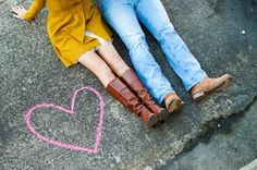 Cute adoption announcement idea? Chalk outline of country (rather than heart) with a pair of baby shoes inside?