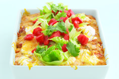What do you call a casserole filled with corn and chicken and fresh peppers layered with tortillas, salsa, sour cream and cheese? We call it one of our faves. You will too.
