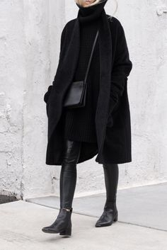 Back to black long black duster coat, black jumper, black crossbody bag, black leather leggings and black ankle boots