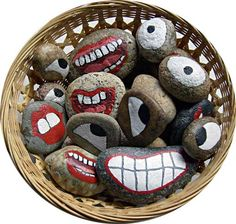 Ha ha fun ! Basket of Stony Face Painted Rocks - mix and match eyes and mouths for funny faces.