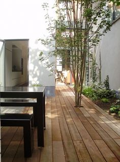 Good use of space.. Clean wood decking underfoot.. A place to sit and eat…
