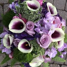Beautiful shades of lavender and purple  purple hydrangea. Picasso calla. Queen Anne's lace, ocean song roses