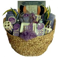 "Zotorius Creations Gift Baskets, LLC ~ Like Us on Facebook! ""Lavender Luxury"" Gift Basket by Zotorius Creations Gift Baskets, LLC consist of the following:  Large Woven Basket; Two Premium Bath Towels ( Lavender); Body Works by Piazzo Lavender scented shower gel, body lotion, bath salt & soap bar; Bathroom Accessories (toothbrush holder, soap dispenser, rinse cup & soap dish; Hand held body massager; Lavender scented floating candles; Hot Stone Massage book & kit and Body wash pouf."