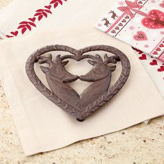 Made from high quality durable cast iron, this heart shaped trivet with stag detailing is perfect for protecting the dining table top and work top surface. Complete with protective rubber feet to prevent damage to a surface. This would make an ideal house warming gift for the winter months ahead
