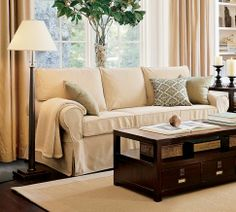 """Our PB couch (we got it in """"Walnut"""")...love the table in this picture too!"""