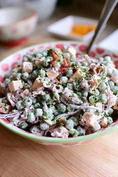 Pioneer Woman's Pea Salad. Bacon, big chunks of cheese, slivers of red onion, and a light, creamy dressing.