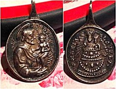 Antique Catholic Medal Saint Joseph Ioseph Sterling Silver Virgin Mary (Image1)St. Joseph and the Christ child on one side and the Blessed Mother Virgin Mary on the reverse. Medal is stamped on the loop. Front: Saint Ioseph Back: Maria Lavret Very dark silver patina.