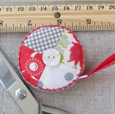 Retractable tape measure covered with pieced by ChosenSisters, $9.00