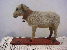 Antique Lamb on Wheels pull Toy.