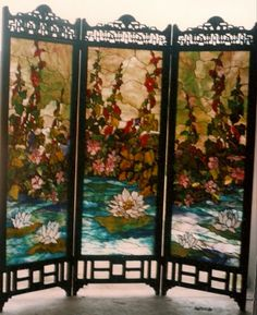 This gorgeous holly and lily decorated #stainedglass screen was made by our resident artist.