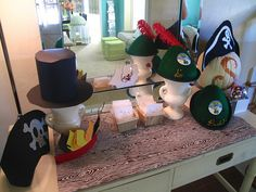 I like the idea of having a dress-up table with hats.