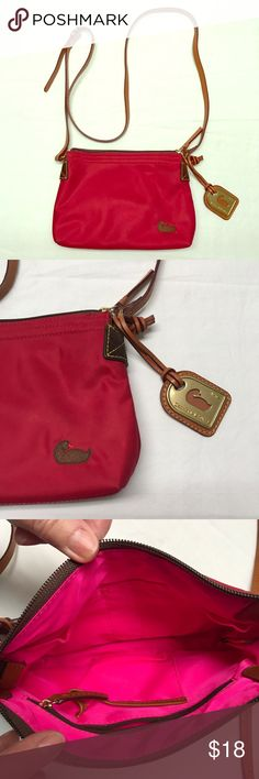 """Red Nylon Dooney & Bourke Cross-body Handbag This red nylon cross body small handbag with leather strap that has 23.5"""" handle drop (on middle hole) with 5 holes for adjustments. Beautiful bright pink lining makes it easy to find things in your bag. 3 inner open pockets and 1 zipper pocket. Dooney & Bourke Bags Crossbody Bags"""