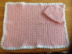 """Neonatal blanket and cap for a premie.  Size:  18""""x24"""". Materials  Soft and cozy yarn  Size I and J crochet hooks  With J hook chain 50  Change to size I hook.  Row 1: SC in 2nd ch from hook. DC in next ch. *SC, DC across. Turn Row 2: Ch1, *DC, SC across - (SC in DC, DC in SC). Repeat from *across.  When NICU blanket reaches 24 inches in length finish off."""