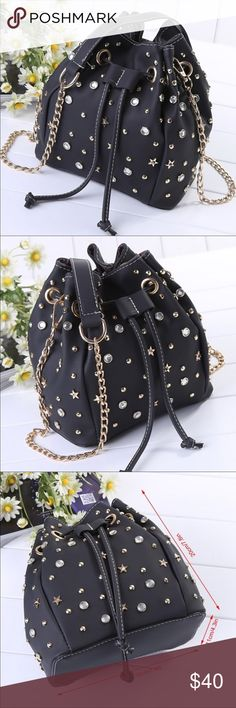 "RHINESTONE BUCKET BAG CUTE BUCKET BAG IN BLACK HIGH QUALITY VEGAN LEATHER WITH STUD AND RHINESTONE EMBELLISHMENTS  THIS CUTIE SUITS FOR MOST OCCASIONS DAY OR NIGHT LINED, 1 SLIP POCKET DRAWSTRING CLOSURE MEASURES APPROX 8 X 7 X 4 STRAP DROP IS APPROX 23"" ❌no trade price firm❌ BOUTIQUE Bags Shoulder Bags"