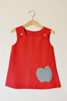 Girls red pfully lined pinafore with green gingham apple applique age 2. $20.00, via Etsy.