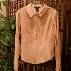 """Fitted Suede/Leather shirt jacket Preloved and in great condition. Very clean. The suede Is very soft. Beige color. Includes hidden hook and eye closure all the way to collar. Also includes hidden hook and eye closure on sleeves. Dimensions are: length from shoulder 23.5"""" and 41"""" across chest. 100% leather. Tops Button Down Shirts"""