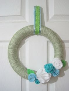 Happy Easter everyone! Remember those felt flowersI made? Well, I told you that I used some to decorate a wreath, and here is the spring/summer wreath I came up with. (By the way, this is the firs...