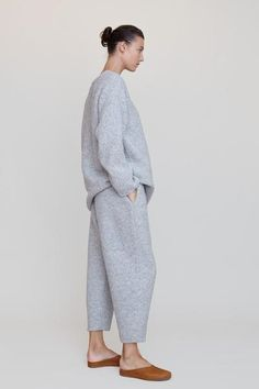 """Cropped, comfy pants in a grey textured knit. Elastic waistband and hidden side pockets. Straight fit. Pair with the Lauren Manoogian Knitweave Crewneck in Grey for the ultimate cozy Fall look. Details 46% Alpaca. 31% Merino. 23% Polyamide. 100% Cotton base. Hand loomed in Peru. Fit Model is 5'10,"""" size 2 wearing size"""