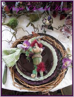 This Woodland Elf Tablescape originates from my former Christmas tree decor and the grapevine wreaths that I mentioned I made in m.