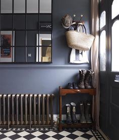 Dark hallway interiors with inky blue walls, a cast iron radiator and window pane wall mirror. Compact shoe storage for hallway. Also, I'd forgotten how much I LOVE chequered floors. Home Design, Flur Design, Interior Design, Modern Interior, Modern Decor, Dark Hallway, Tiled Hallway, Hallway Mirror, Hallway Paint