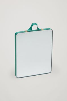 A simple design, this mirror is a clean square shape with bright coloured grosgrain ribbon and oak veneer backing.