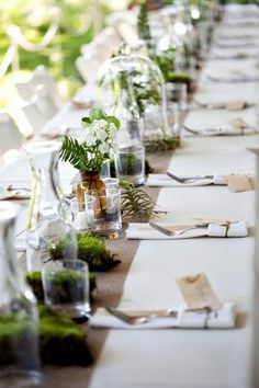 Terrariums make very cool table displays. Team them up with moss, logs, branches, wood discs or wheat grass.