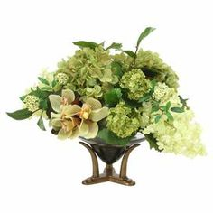 "Add an organic touch to your entryway console table or kitchen counter with this lovely faux hydrangea and orchid arrangement, nestled in a bronze-hued planter.  Product: Faux floral arrangementConstruction Material: Silk and glassColor: Green and bronzeFeatures: Includes faux hydrangeas, orchids, and snowballsDimensions: 16"" H x 20"" DiameterAssembly: No assembly requiredCleaning and Care: Dust lightly"