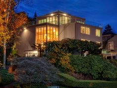 First time on open market. Famed architect Roland Terry 5150 sq ft masterpiece says you've arrived. Grand entertainment home; 4 glass stories overlook Seattle Tennis Club, sweeping lake/mtn/city views. The art of living well taken to new heights: expansive 10.5 sunlit rms, private terraces, 1226 sq ft of sundecks, 4 fireplaces, majestic view master w/mezzanine, library w/wine storage, Cloud Room w/Jacuzzi & glass ceils to the stars. Private lot is 14000 sq ft use-entitled, only 7800 sq ft taxed.