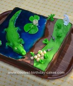 Homemade Crocodile Birthday Cake: My son woke up and said: I want a cake with a river, a big crocodile and with water lilies in it. On the shore there should be some mice running. On the