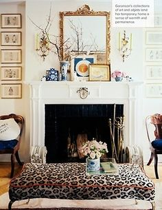 I miss not having a fireplace! This mantle arrangement is gorgeous... minus the chair