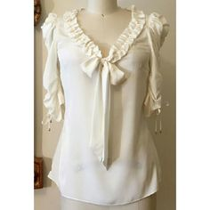 """Anthropologie Leifsdottir Cream Ruffle Bow Top Like new. 100% poly. Metal tipped ties at sleeves with bow tie at front. Hidden side zip. 26"""" long. Anthropologie Tops Blouses"""