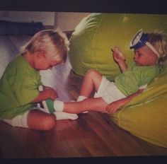 Rocky helping Ross with his shoes. Too cute.