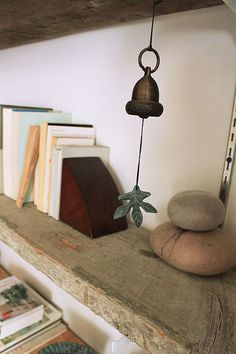Love this reclaimed plank sitting atop a white shelf bracket.