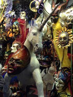 Masks in window on Strada Nova