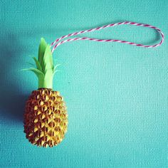 #pineapple #christmas #ornament made from a seed from a tree, paint, paper and twine