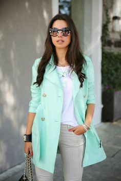 White blouse with bright turquoise stylish long coat and grey casual plan jeans and hand bag the perfect outfits