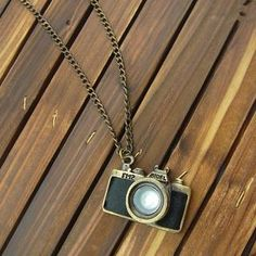 Camera pendant necklace.