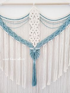 glitter and twine embellishments hanging from a wood dowel rod Handmade macrame mermaids tail wall hanging wfaux pearls
