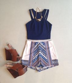 Royal blue crop top, white patterned high shorts, brown rustic heels and a gold chained necklace.
