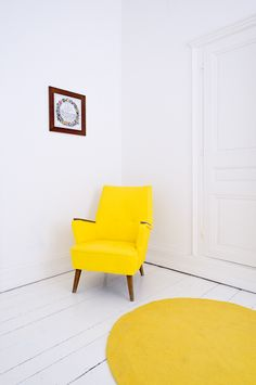 Not particularly this chair, but the concept of a bright stand alone feature chair in yellow.