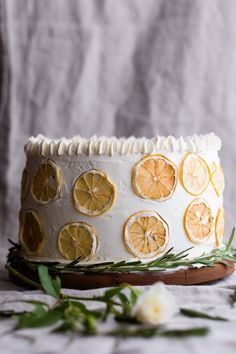 This light and classic Rosemary Sponge Cake is layered with rosemary infused apricot compote and white chocolate buttercream frosting.