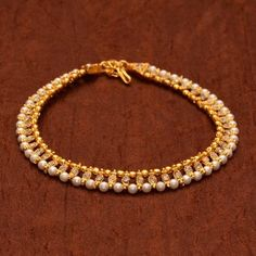 Anvi's beautiful anklets with pearls and white stones(gold toned)